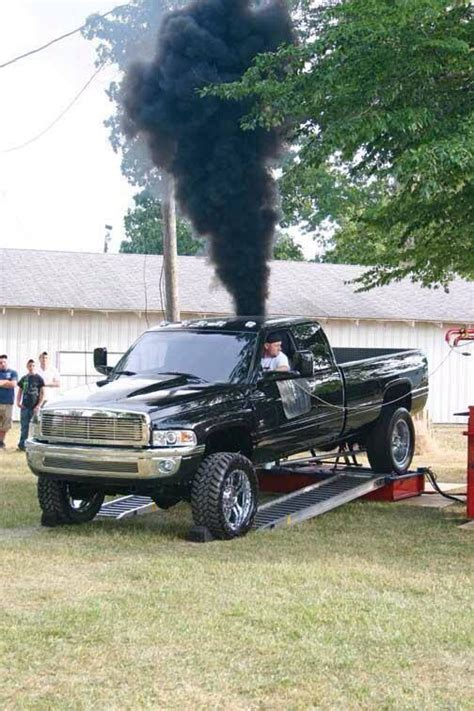 cummins charger rollin coal dodge cummins diesel rolling coal pickup trucks