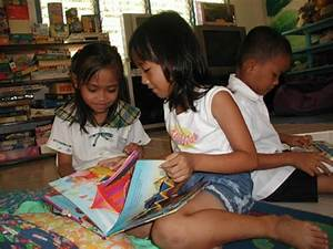 Girls enjoy reading books - Philippine School Charity