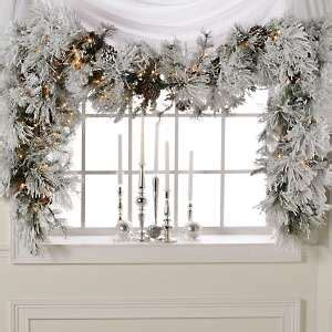 colin cowie  flocked white garland  lights