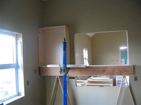 how to install upper cabinets installing cabinets uppers or lowers first