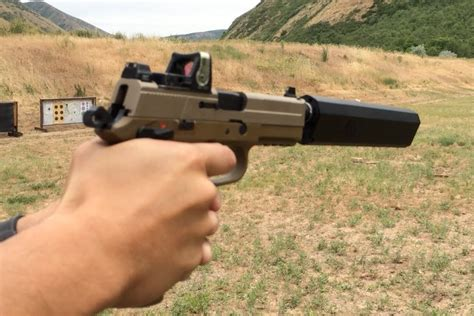 FN FNP 45 Tactical, Silencerco Osprey Suppressor, Trijicon ...
