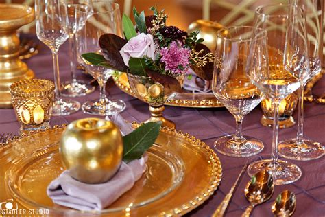 Elegant gold and purple wedding table decor takes barn
