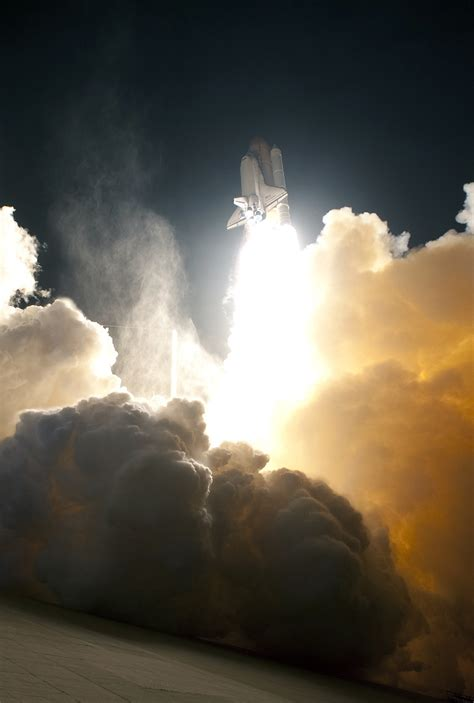 space shuttle launch clouds