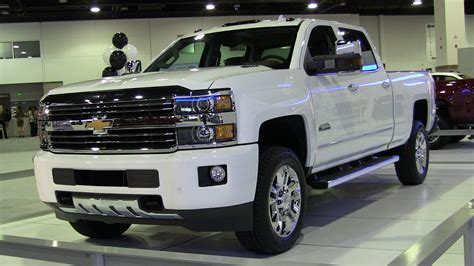 chevy silverado hd high country debuts   denver auto show  fast lane truck