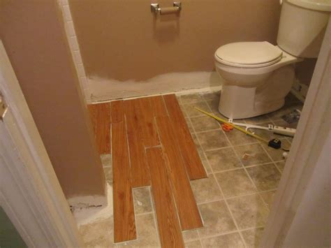 peel and stick floor tile reviews vinyl wood bathroom and took me an hour to do this whole