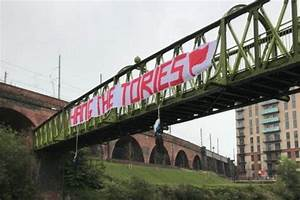 'Hang the Tories' banner on Salford bridge is widely ...