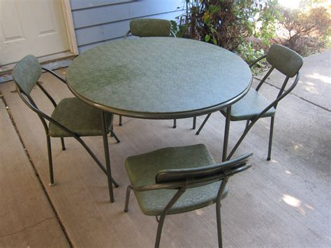 cosco table and chairs 1950 39 s cosco folding table and 4 chairs vinyl tubular