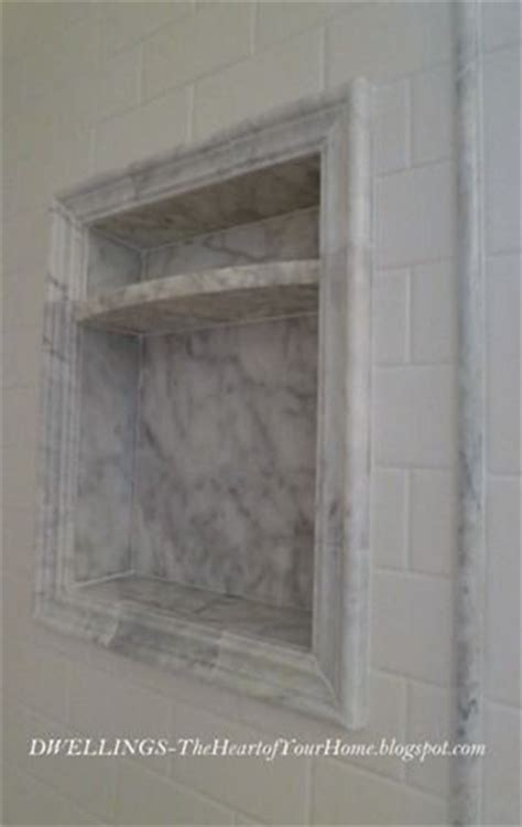marble shower shelf carrera marble accents with white subway tile rowhouse renovation ideas pinterest marble