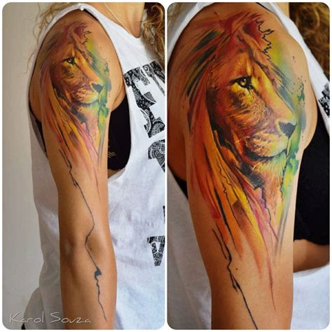 colorful girls arms lion tattoo