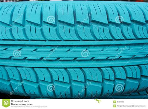 Old Car Tire Painted With Turquoise Color Stock Photo