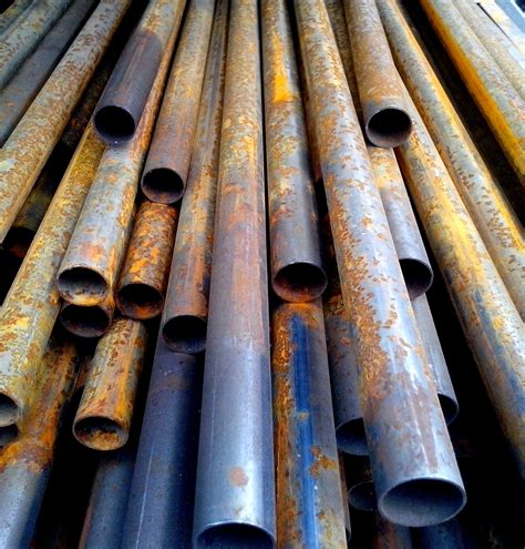 metal pipes round rusty stacked objects kb pixnio