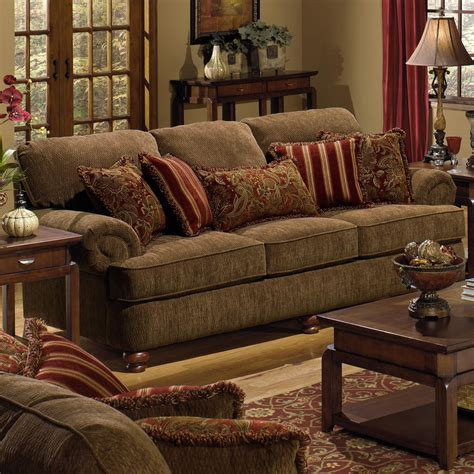 sofa with rolled arms and decorative pillows