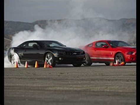 shelby gt crushes camaro ss drag race showdown