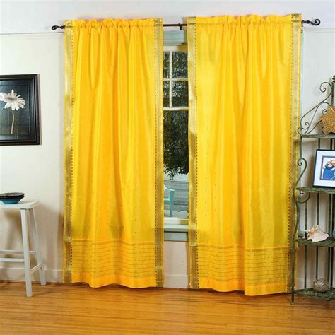 pair of yellow rod pocket sheer sari curtains 80 x 63 in