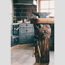 Tree Trunk With Tools And An Anvil In A Luxury Cast Iron