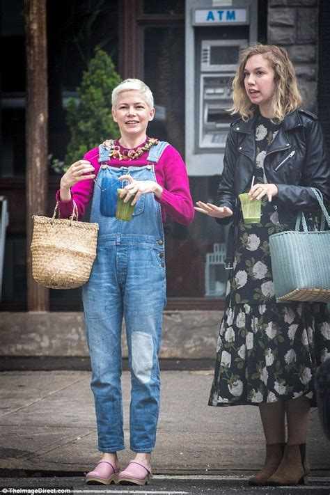 Overall Michele williams wears overalls and a garland to