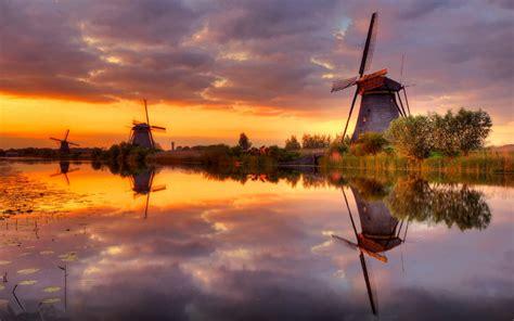 sunset wind channel water dark cloud orange sky reflection