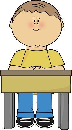 Student Sitting At Desk Clipart by Boy Sitting At School Desk Clipart Classroom Bulletin