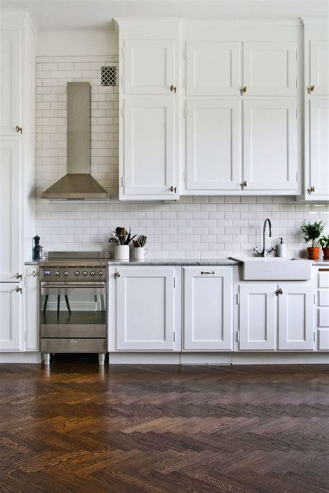 white cabinets tile floor dress your kitchen in style with some white subway tiles 349 | White kitchen design with a rustic floor