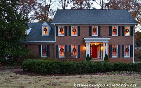 how to hang christmas lights inside windows hanging wreaths on windows