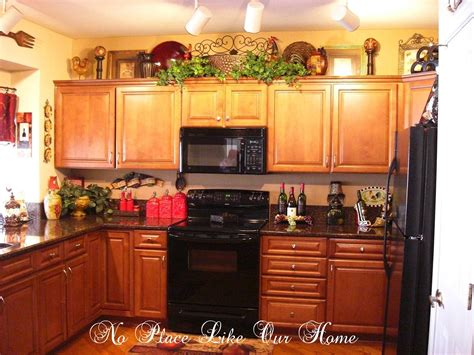 Decorating Ideas For Kitchen Cabinet Tops by Decorating Above Kitchen Cabinets Tuscany Here S A