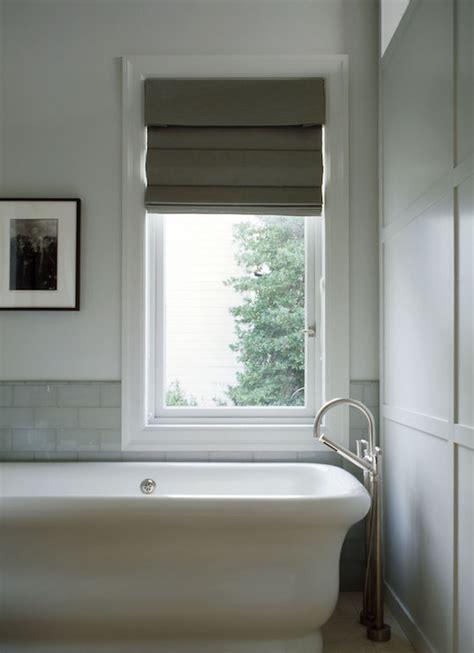 marble tiled tub  window dressed  gray geometric