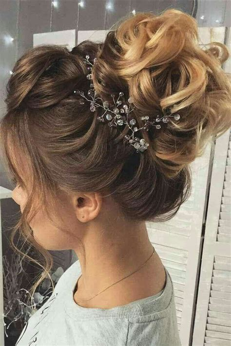 relaxed french braid curly wavy up do bun for wedding or