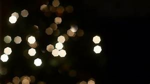 blurry colorful christmas lights in black background video ...