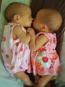 Identical twin girls......I just want to cuddle them right ...