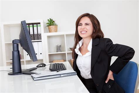 back pain from sitting at desk combating back pain from office chairs green oaks spine