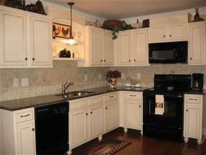 kitchens with black appliances 1496