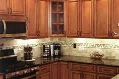 metro cabinets granite creations airstone backsplash in kitchen quot autumn mountain quot maple