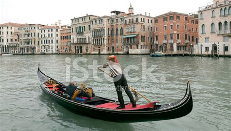 Gondola Boat Man by Boatman In A Gondola On The Grand Canal In Venice Stock