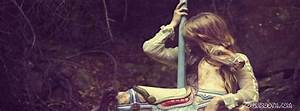 cute lonely girl sitting on carousel crying , face hidden ...