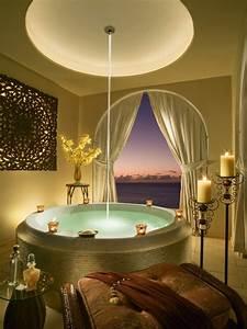 Jolis decors avec une baignoire ronde archzinefr for Salle de bain design avec bougie décorative oriental
