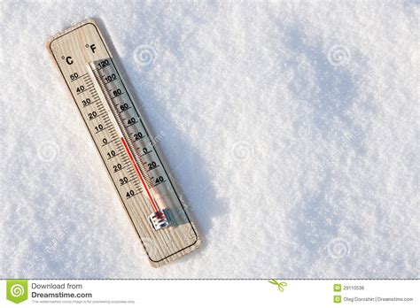 Thermometer In The Snow With Zero Temperature Stock Photo