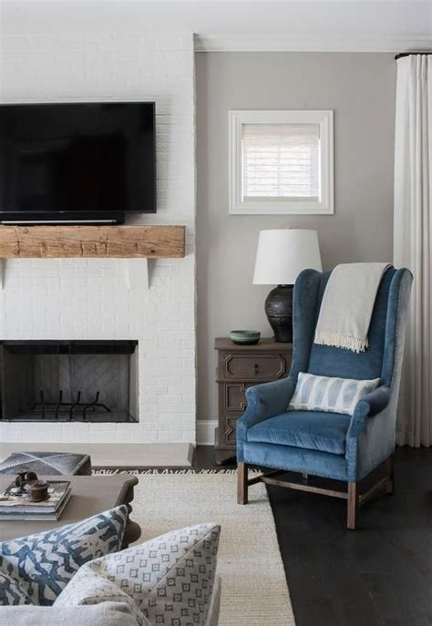 welcoming white and blue living room features a flat panel