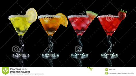 red martini yellow orange pink and red martini drinks stock photo