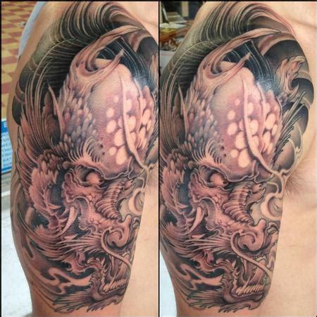 art junkies tattoo studio tattoos traditional japanese dragon black  grey traditional