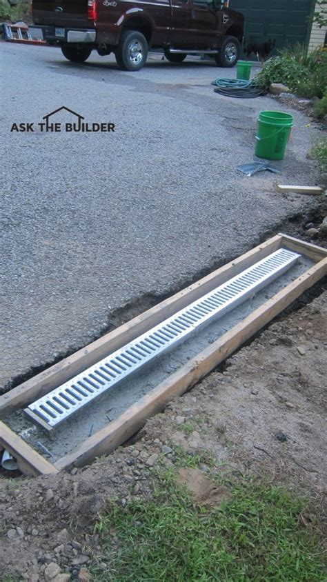 sidewalk trench drain how to install a trench drain ask the builder 2210