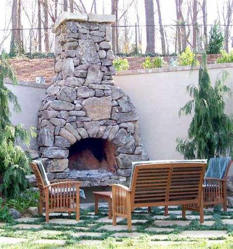 outdoor stone fireplace   garden  cozy place