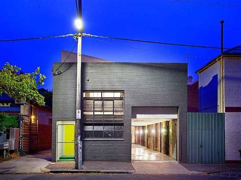 beautiful brick walls warehouse conversion  fitzroy conceals twin delights