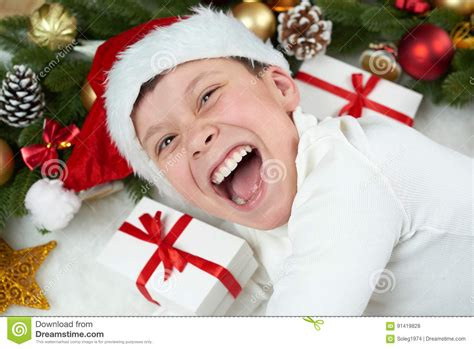 Boy Child Having Fun With Christmas Decoration, Face Expression And Happy Emotions, Dressed In