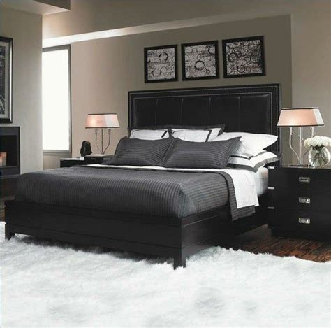 masculine white bedroom very masculine bedroom light grey walls white bedding and rug balance dark bedding furniture