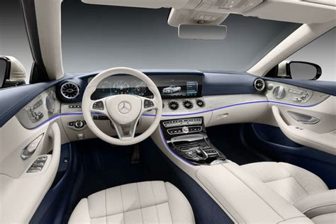 The interior lighting makes exclusive use of. 2018 Mercedes-Benz E-Class Cabriolet front interior driver dash and infotainment system_o ...