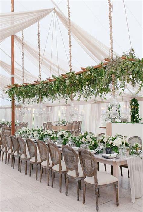 hanging trellis covered  greenery brides