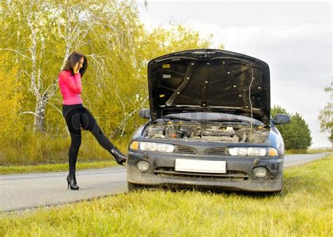young woman   broken car stock photo colourbox