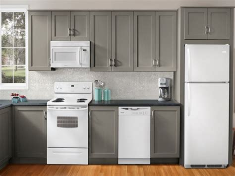white kitchen cabinets with white appliances topnotch and