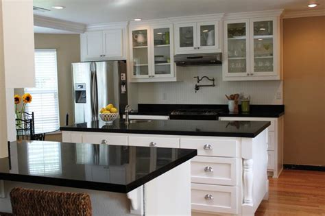 white kitchen cabinets and black countertops kitchen black countertops white cabinets saura v dutt 2049