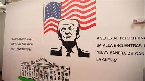 immigrant children detention center  mural  trump